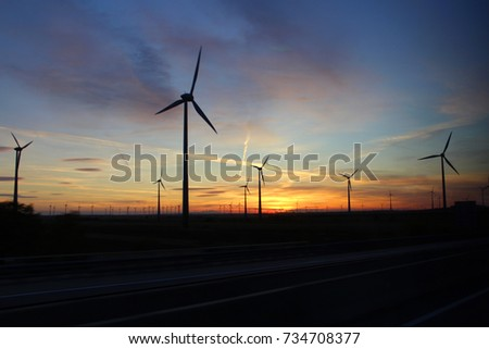 Alternative energy windmills in Eastern Europe, Windmills on the Sunset view
