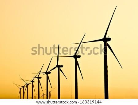 Alternative energy with wind turbine - stock photo