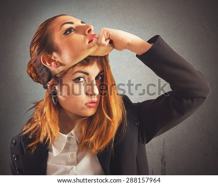 Alternative girl with piercing unmask a good girl - stock photo