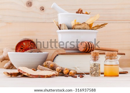 Alternative Medicinal , Chinese herbal medicine  for healthy recipe with dry herbs  and mortar on wooden background. - stock photo