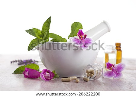 alternative medicine and therapy- herbal supplements and essential oils - stock photo