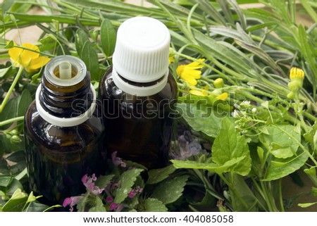 Alternative medicine concept.Bottles with organic essential aroma oil from wildflowers plants - stock photo