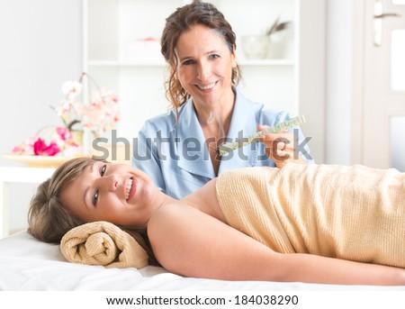 Alternative medicine therapist doing moxa treatment on her client - stock photo