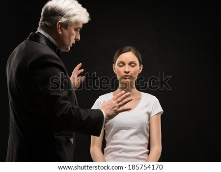 Alternative medicine therapist using hypnosis to heal his patient - stock photo