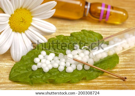 alternative medicine with acupuncture and herbal pills - stock photo