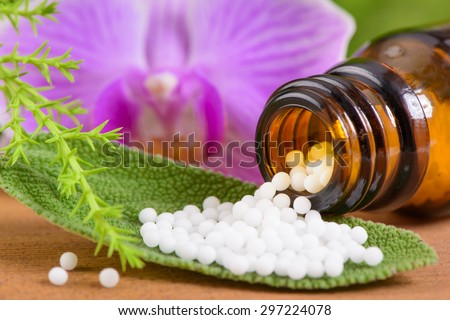 alternative medicine with homeopathic pills - stock photo