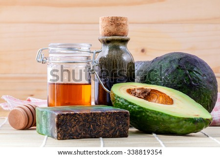 Alternative skin care  and scrub fresh  avocado , oils , honey  and  avocado soap on wooden background. - stock photo