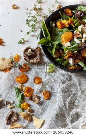 alternative vegan salad with rocket, carrots chips, walnuts and seeds in japanese bowl  - stock photo