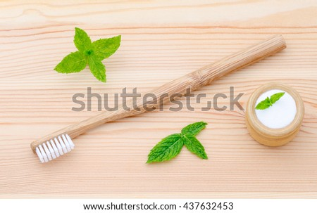 alternative wood toothbrush and xylitol, soda, powder, salt, mint on wooden