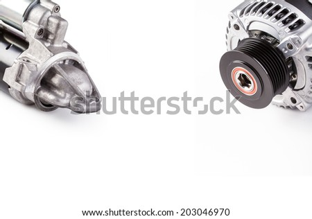 Alternator. Starter. Generator and starter. Car aggregates. Alternator and starter for car. Electrical units for car. Auto parts. Composition of the two electrical  parts for the engine.  - stock photo