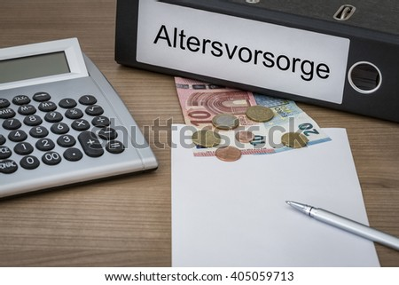 Altersvorosorge (German retirement provision) written on a binder on a desk with euro money calculator blank sheet and pen