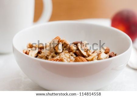 Although they take longer to cook, steel cut oats have a nuttier flavor and chewier texture than rolled or instant oatmeal. - stock photo