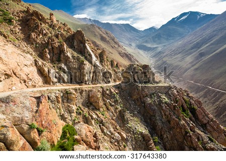 Altitude road and snowy rock mountain rage in summer   - stock photo
