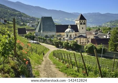 Alto Adige - Neustift monastery surrounded by vineyards, Italy - stock photo