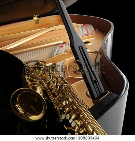 Alto saxophone on grand piano - stock photo