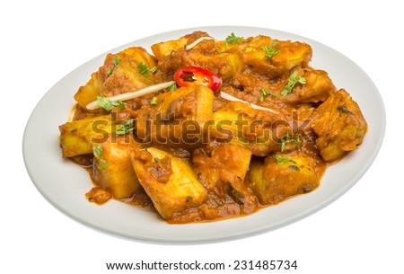 Alu Bengan - indian potatoes and eggplant - stock photo