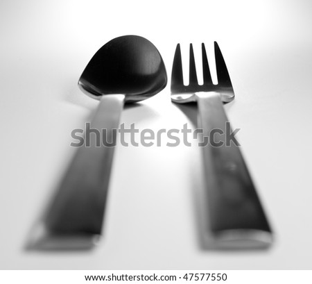 Aluminium fork and spoon on gray - stock photo