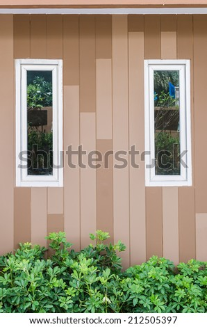 aluminium windows with wall pattern and plants