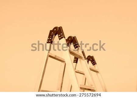 aluminum alloy ladder under sky, closeup of photo - stock photo