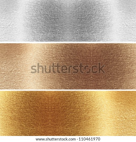 Aluminum, brass and golden plates with some reflected lights and reflections - stock photo