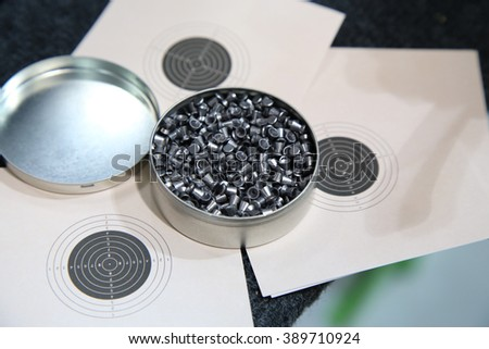 aluminum can of lead pellets for air rifle and target - stock photo