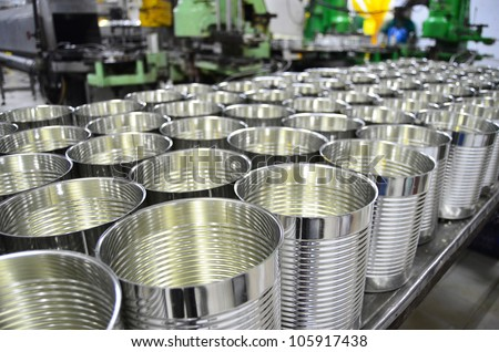 Aluminum Cans in factory warehouse - stock photo