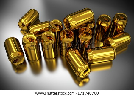 aluminum cans of gold color on a reflective surface - stock photo