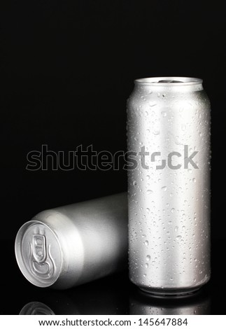 Aluminum cans with water drops isolated on black - stock photo