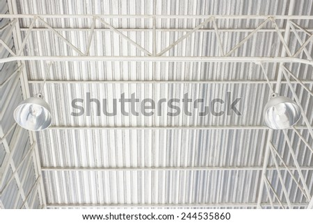 aluminum ceiling lamp with storehouse roof - stock photo