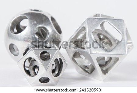 aluminum details on a white background. The old, covered with corrosion aluminum figures. Difficult figures from aluminum made on the milling machine.  - stock photo