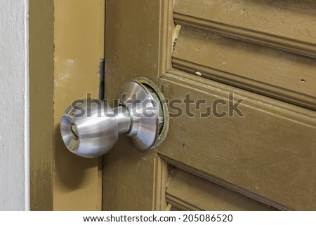Aluminum door knob damage - stock photo