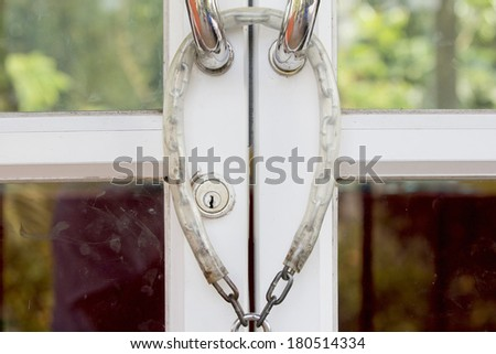 Aluminum door lock with chain in a day - stock photo