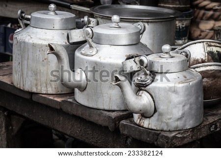 aluminum kettle for Indian masala tea with glass  - stock photo