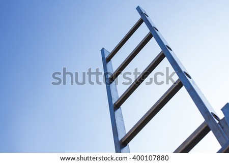 aluminum ladder and blue sky - stock photo