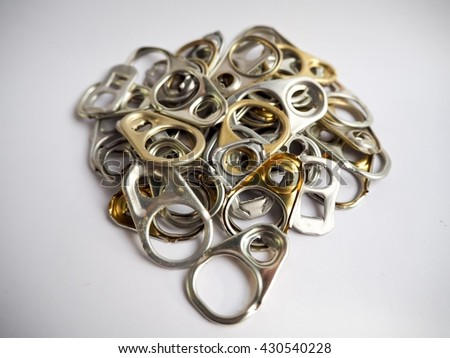 Aluminum ring pulls isolated on white background , recycled ring - stock photo