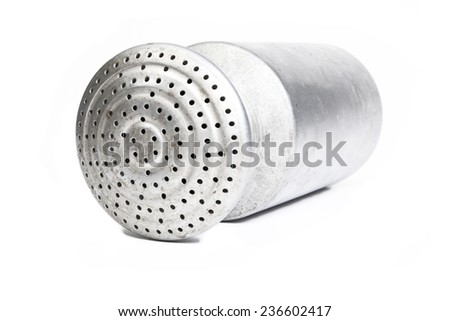 Aluminum salt shaker lying in front of a white background