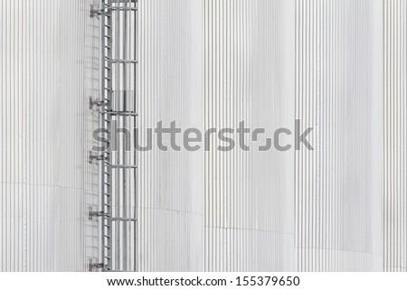 aluminum silo background with Fixed ladder. - stock photo