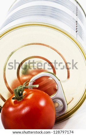 Aluminum tin can and tomato on a white background. - stock photo