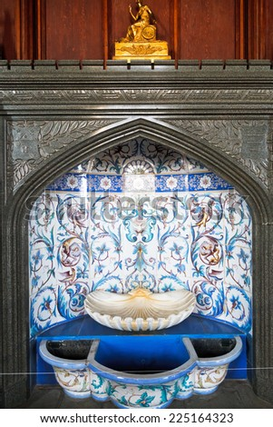 ALUPKA, RUSSIA - SEPTEMBER 28, 2014: fountain in formal dining room in Vorontsov (Alupka) Palace in Crimea. The palace was built between 1828 and 1848 for Prince Vorontsov for use as summer residence