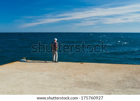 Alupka, Ukraine - September 21, 2011: Sea fishing as a typical hobby for men into retirement.