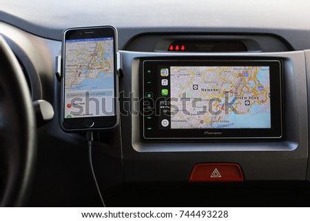 Alushta, Russia - April 20, 2017: iPhone with Apple Maps on the screen and Car Play on the multimedia system. iPhone, Apple Maps and Car Play was created and developed by the Apple inc.