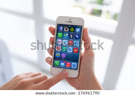 Alushta, Russia - July 14, 2014: Displaying social media network program known brands on the screen iPhone from Apple. - stock photo