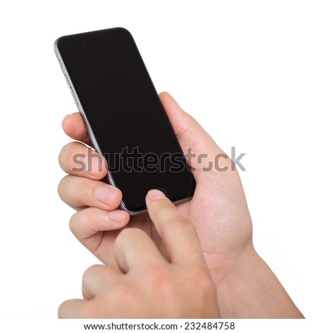 Alushta, Russia - November 13, 2014: Man holding in the hand Isolated new phone iPhone 6 Space Gray. iPhone 6 was created and developed by the Apple inc. - stock photo