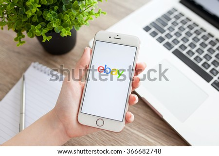Alushta, Russia - November 5, 2015: Woman holding a iPhone 6S Rose Gold with service Ebay on the screen. iPhone 6S was created and developed by the Apple inc. - stock photo