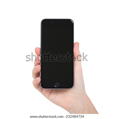 Alushta, Russia - November 13, 2014: woman holding in the hand Isolated new phone iPhone 6 Space Gray. iPhone 6 was created and developed by the Apple inc. - stock photo