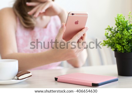 Alushta, Russia - October 27, 2015: Woman holding in the hand iPhone6S Rose Gold. iPhone 6S Rose Gold was created and developed by the Apple inc. - stock photo