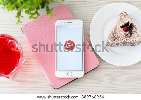 Alushta, Russia - October 25, 2015: Woman holding iPhone6S Rose Gold with social networking service Google Plus on the screen. iPhone 6S Rose Gold was created and developed by the Apple inc. - stock photo