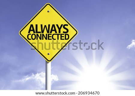 Always Connected road sign with sun background  - stock photo