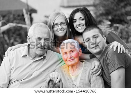 Alzheimer 's concept - when the world closes in. An elderly woman surrounded by her family. - stock photo