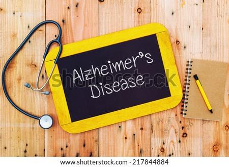 Alzheimer's disease written on chalkboard and stethoscope,medicine concept.  - stock photo